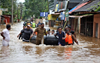 Rescuers evacuate people from a flooded area to a safer place in Aluva, Kerala after the worst monsoon rains in 100  years devastated local communities. 